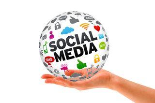 Bigstock-Hand-Holding-A-Social-Media-D-30332120