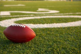Bigstock-Pro-American-Football-on-the-F-50332916