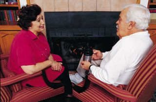 Old couple having coffee